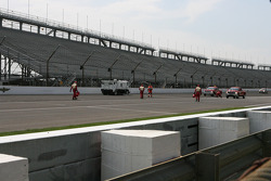Crews cleanup the debris from Conor Daly's crash