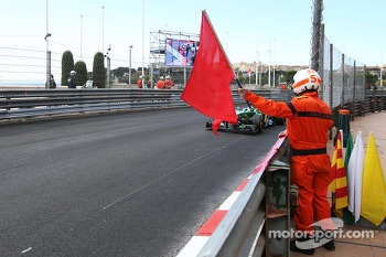 Charles Pic, Caterham CT03 passes a red flag held out by marshal