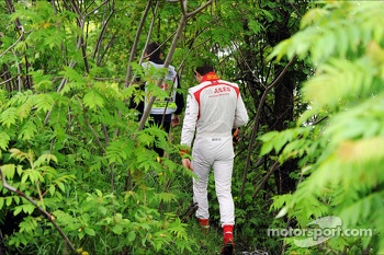 Jules Bianchi, Marussia F1 Team walks through the undergrowth after stopping in the first practice session