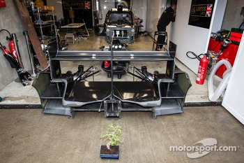A bonsai in front of the Lotus Praga garage