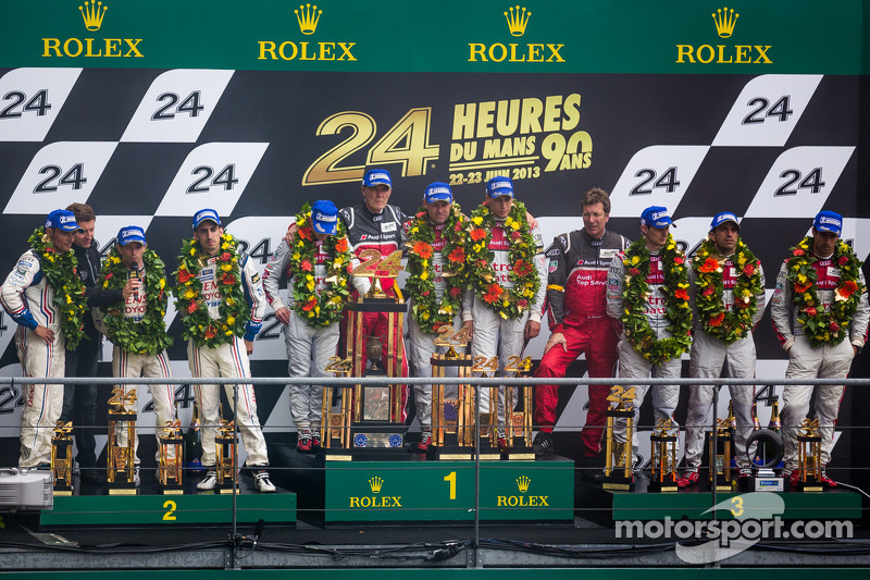 LMP1 podium: class and overall winners Tom Kristensen, Allan McNish, Loic Duval, second place Anthony Davidson, Stéphane Sarrazin, Sebastien Buemi, third place Marc Gene, Oliver Jarvis, Lucas di Grassi
