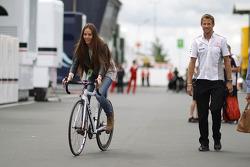 Jessica Michibata, rides a bicycle alongside boyfriend Jenson Button, McLaren