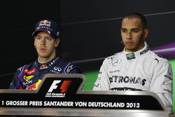(L to R): Sebastian Vettel, Red Bull Racing and pole sitter Lewis Hamilton, Mercedes AMG F1 in the FIA Press Conference