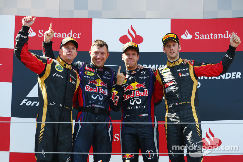 Podium: race winner Sebastian Vettel, second place Kimi Raikkonen, third place Romain Grosjean