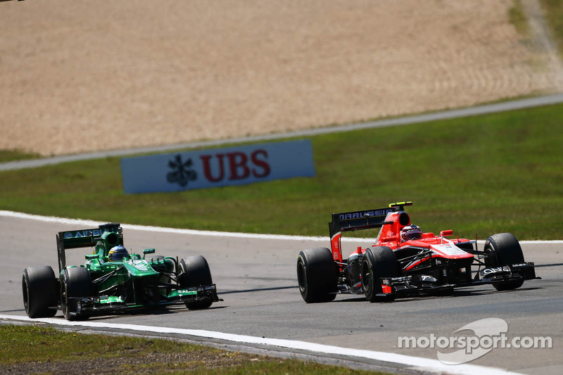 Max Chilton, Marussia F1 Team MR02 battles with Charles Pic, Caterham CT03