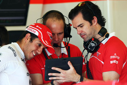 Rodolfo Gonzalez, Marussia F1 Team Reserve Driver, with Marc Hynes, Marussia F1 Team Driver Coach (Right)