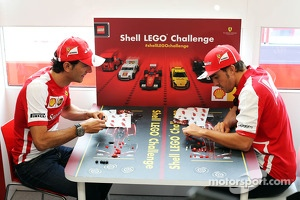 (L to R): Pedro De La Rosa, Ferrari Development Driver and Fernando Alonso, Ferrari play the Ferrari Shell Lego Challenge