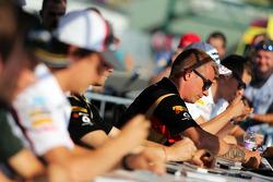 Kimi Raikkonen, Lotus F1 Team signs autographs for the fans