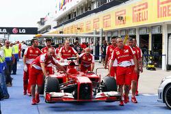 Ferrari F138 pushed to scrutineering
