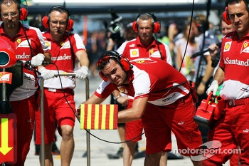 Ferrari mechanics in the pits