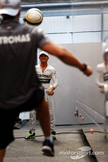 Nico Rosberg, Mercedes AMG F1 practices his football skills with Daniel Schloesser, Mercedes AMG F1 Physio