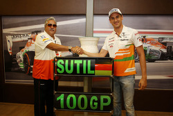 Dr. Vijay Mallya, Sahara Force India F1 Team Owner presents a ceramic wheel rim, signed by the team, to Adrian Sutil, Sahara Force India F1, who is celebrating his 100th GP