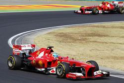 Fernando Alonso, Ferrari F138 leads team mate Felipe Massa, Ferrari F138