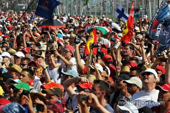 Fans invade the circuit at the podium