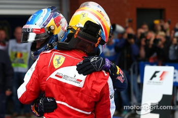 2nd place Fernando Alonso, Ferrari and 1st place Sebastian Vettel, Red Bull Racing