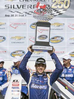 Race winner Chase Elliott celebrates