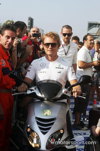 Nico Rosberg, Mercedes AMG F1 on a moped in the pits