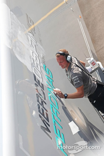 Mercedes AMG F1 truck is cleaned by a mechanic