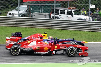 Fernando Alonso, Ferrari F138 and Mark Webber, Red Bull Racing RB9 battle for position