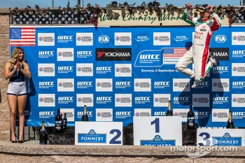 Gabriele Tarquini getting some air on the podium after winning race 2