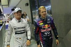 Nico Rosberg, Mercedes AMG F1 with pole sitter Sebastian Vettel, Red Bull Racing in parc ferme