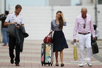 (L to R): Jenson Button, McLaren with girlfriend Jessica Michibata, and father John Button