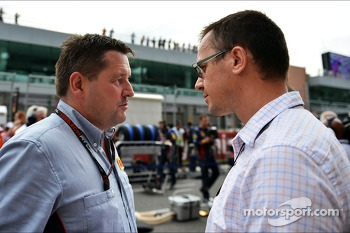 (L to R): Paul Hembery, Pirelli Motorsport Director with Jonathan Noble, Autosport Journalist on the grid