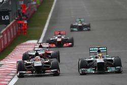 Sergio Perez, McLaren MP4-28 and Lewis Hamilton, Mercedes AMG F1 W04