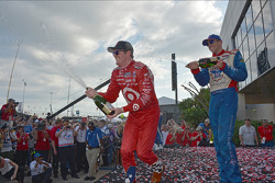Race winner Scott Dixon, third place Justin Wilson