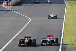Kimi Raikkonen, Lotus F1 Team and Jenson Button, McLaren Mercedes