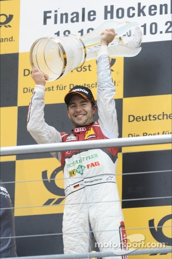 champion Mike Rockenfeller, Audi Sport Team Phoenix Racing, with trophy
