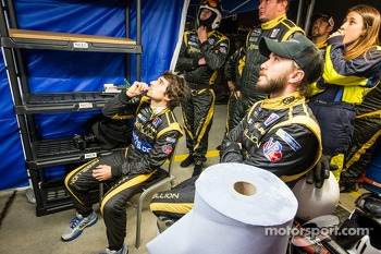 Nick Heidfeld, Nicolas Prost and Rebellion Racing team members watch the end of the race
