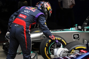 Pole sitter Sebastian Vettel, Red Bull Racing uses a fan to cool the brakes on his Red Bull Racing RB9