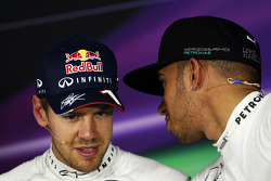 F1: (L to R): Sebastian Vettel, Red Bull Racing with Lewis Hamilton, Mercedes AMG F1 in the FIA Press Conference