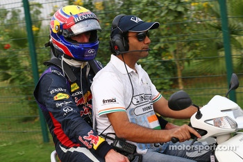 Mark Webber, Red Bull Racing heads back to the paddock after he retired from the race