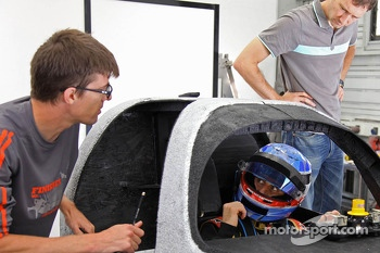 Nicolas Prost sits in a full scale mock-up of the Rebellion R-One