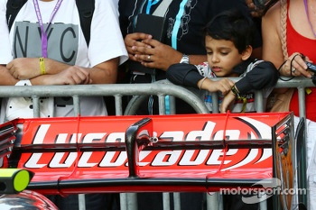 A young fan looks at the McLaren MP4-28