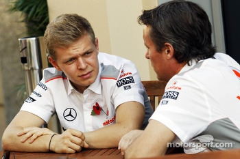 (L to R): Kevin Magnussen, McLaren Test Driver with Sam Michael, McLaren Sporting Director