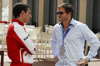 (L to R): Andrea Stella, Ferrari Race Engineer with Dave Robertson, Driver Manager of Kimi Raikkonen, Lotus F1 Team