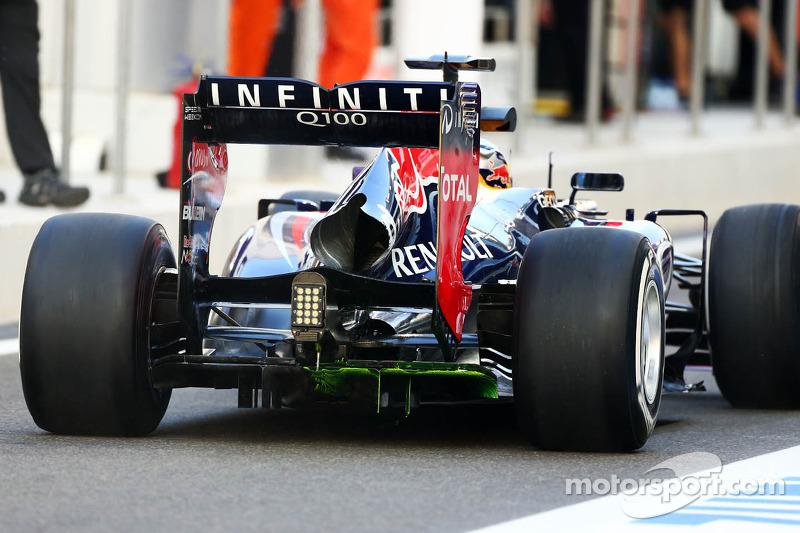 Sebastian Vettel, Red Bull Racing RB9 running flow-vis paint on the rear diffuser