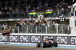 Race winner Sebastian Vettel, Red Bull Racing RB9 takes the chequered flag at the end of the race
