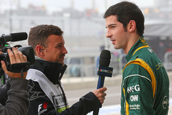 (L to R): Will Buxton, NBS Sports Network TV Presenter with Alexander Rossi, Caterham F1 Reserve Driver