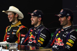 The FIA Press Conference: Romain Grosjean Lotus F1 Team, second; Sebastian Vettel, Red Bull Racing, race winner; Mark Webber, Red Bull Racing, third