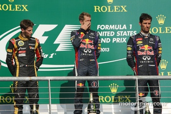 The podium, Lotus F1 Team, second; Sebastian Vettel, Red Bull Racing, race winner; Mark Webber, Red Bull Racing, third