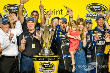 Championship victory lane: NASCAR Sprint Cup Series 2013 champion 2013 Jimmie Johnson, Hendrick Motorsports Chevrolet with wife Chandra and his team