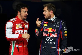 (L to R): Fernando Alonso, Ferrari and pole sitter Sebastian Vettel, Red Bull Racing in parc ferme