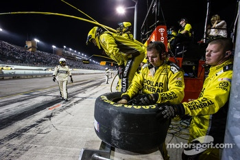 Joe Gibbs Racing Toyota crew members get ready for a pit stop
