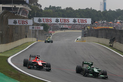 (L to R): Jules Bianchi, Marussia F1 Team MR02 and Charles Pic, Caterham CT03 battle for position