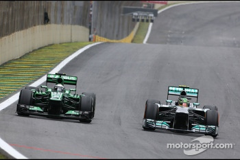 Giedo van der Garde, Caterham F1 Team and Lewis Hamilton, Mercedes Grand Prix
