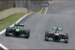 Giedo van der Garde, Caterham F1 Team and Lewis Hamilton, Mercedes Grand Prix